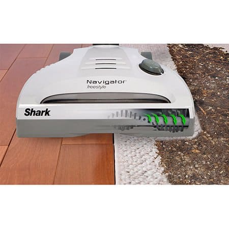 image shows the shark navigator head with the beater bar on both a carpet and a hardwood.