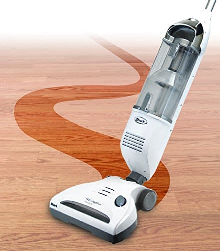 image shows the shark navigator stick vacuum demonstrating the swivel head that provides easy maneuvering