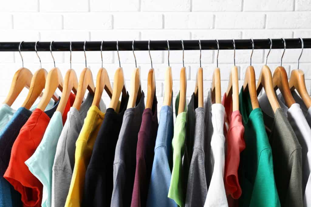 image of shirts hanging neatly in a closet